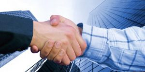 business hand shake deal in colour with a toned background to match colours family of sleeves